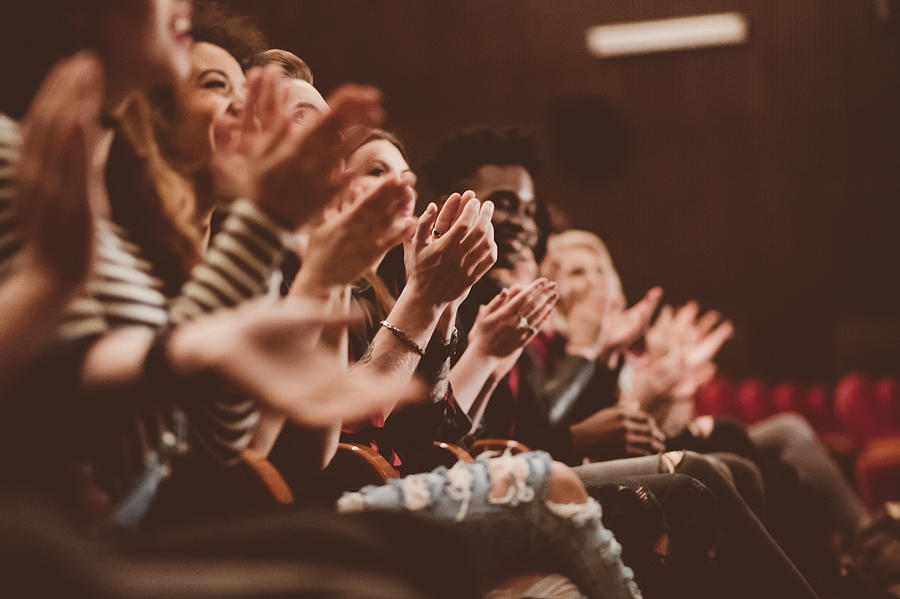 Audience applauding in the theater Photograph by Izabela Habur
