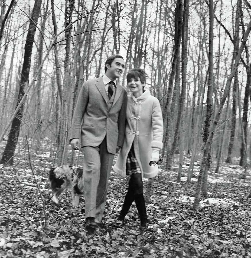 Audrey Hepburn And Husband Walking In The Woods Photograph by Henry Clarke