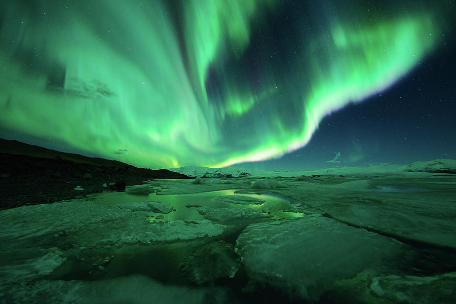 Aurora Display Over The Glacier Lagoon Photograph by Natthawat