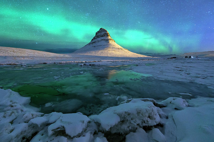 Aurora Over Kirkjufell Mountain Iceland Photograph by Ratnakorn Piyasirisorost