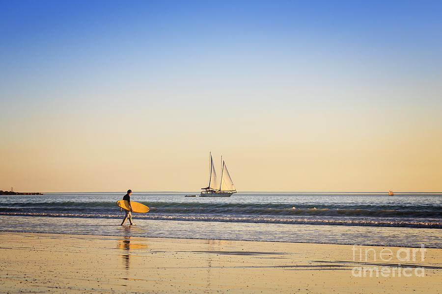 Ambience Photograph - Australia Broome Cable Beach Surfer And Sailing Ship by Colin and Linda McKie