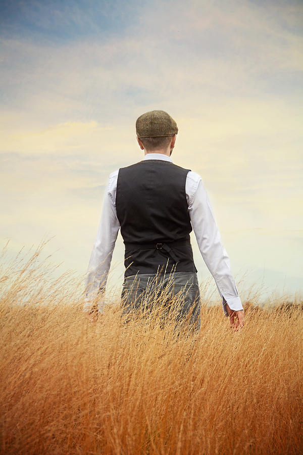 Back Of Man Standing In Tall Grass Photograph by Vesna Armstrong