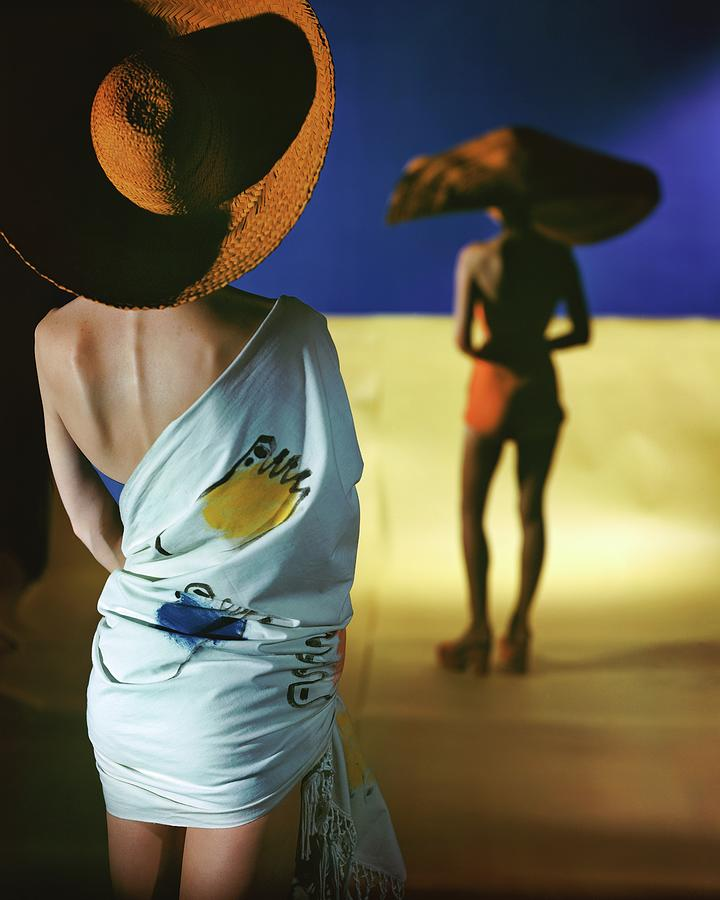 Back View Of Two Models Wearing Sarongs Photograph by Serge Balkin