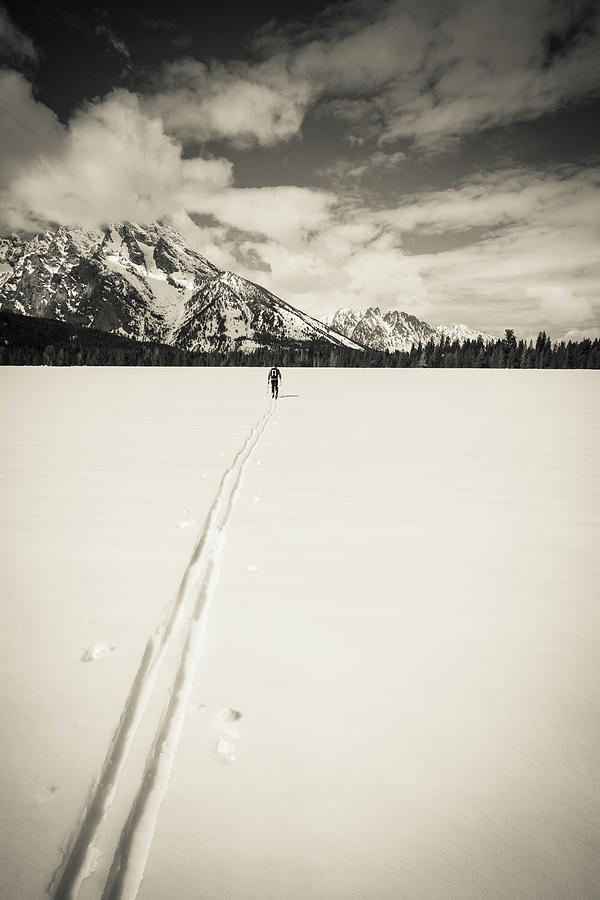 Active Photograph - Backcountry Skier Under Mount Moran by Russ Bishop