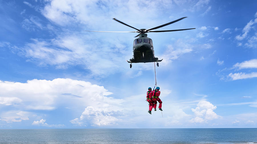 Background concept for Rescue helicopter in mission sea rescue . Photograph by Sarote Pruksachat