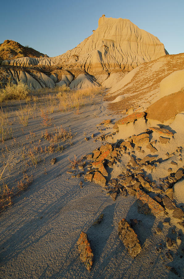 Badlands Formations At Dinosaur Photograph by Rebecca Schortinghuis