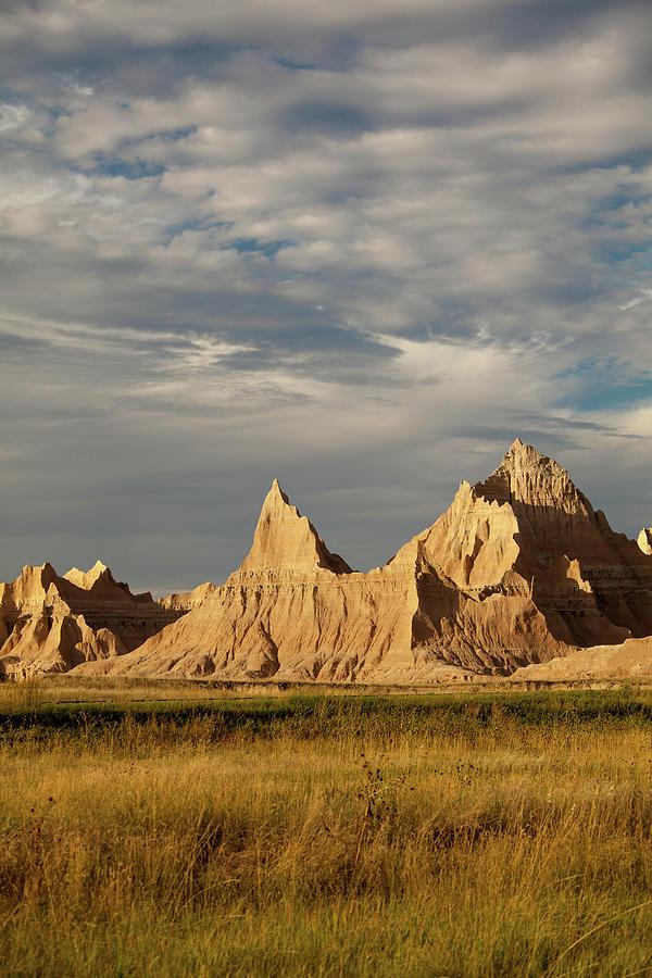 Badlands Landscape In Late Day Light Photograph by Karen Desjardin