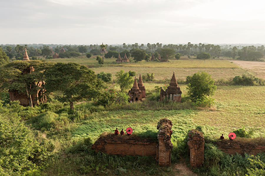 Bagan, Buddhist Monks Sitting Amongst Photograph by Martin Puddy