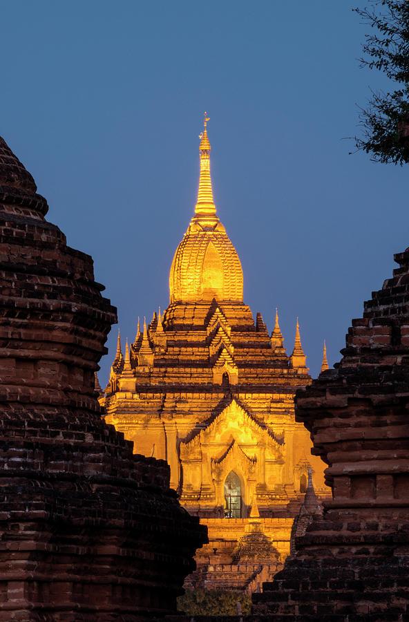 Bagan, Illuminated Temple At Dusk Photograph by Martin Puddy