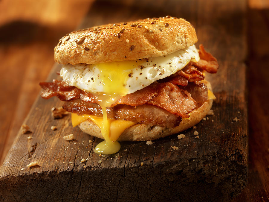 Bagel, Bacon, Sausage and Egg Breakfast Sandwich Photograph by LauriPatterson