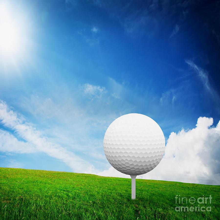 Ball On Tee On Green Golf Field Photograph