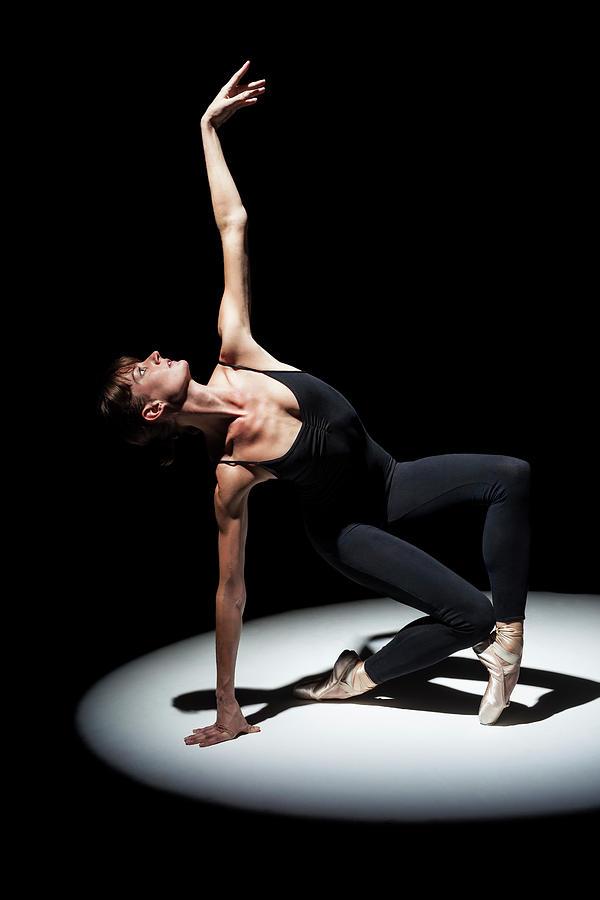 Ballerina In Spotlight With Arm Raised Photograph by Nisian Hughes