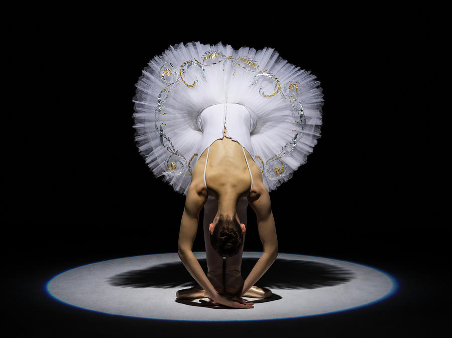 Ballerina In Tutu Folding Forward Under Photograph by Nisian Hughes