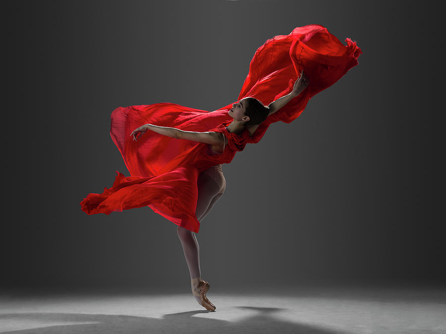 Ballerina Performing On Pointe In Red Photograph by Nisian Hughes