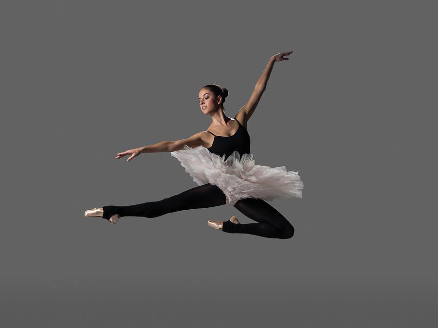 Ballerina Performing Pas De Chat Photograph by Nisian Hughes
