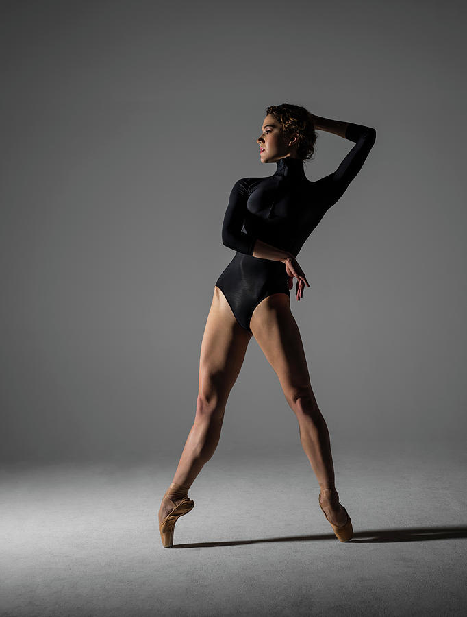 Ballerina Performing Relevé On Point Photograph by Nisian Hughes