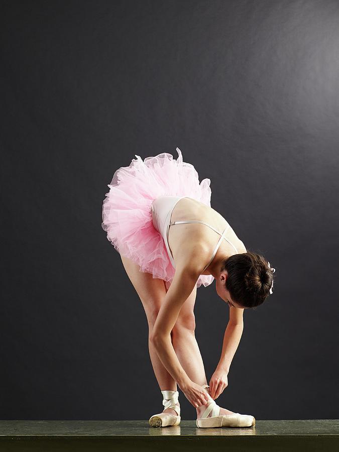 Ballet Dancer Tying Shoe Photograph by Blake Little