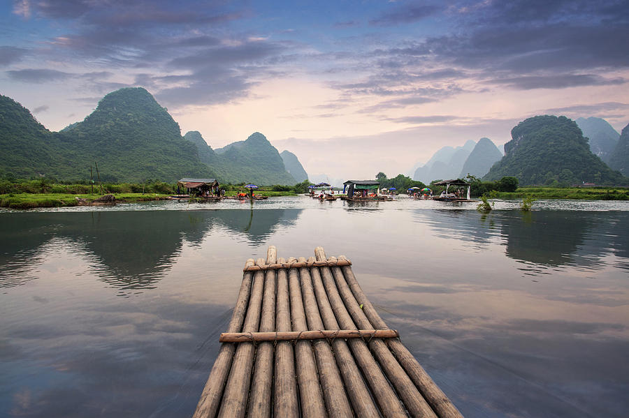 Bamboo Raft On Yulong River Photograph by Ray Wise