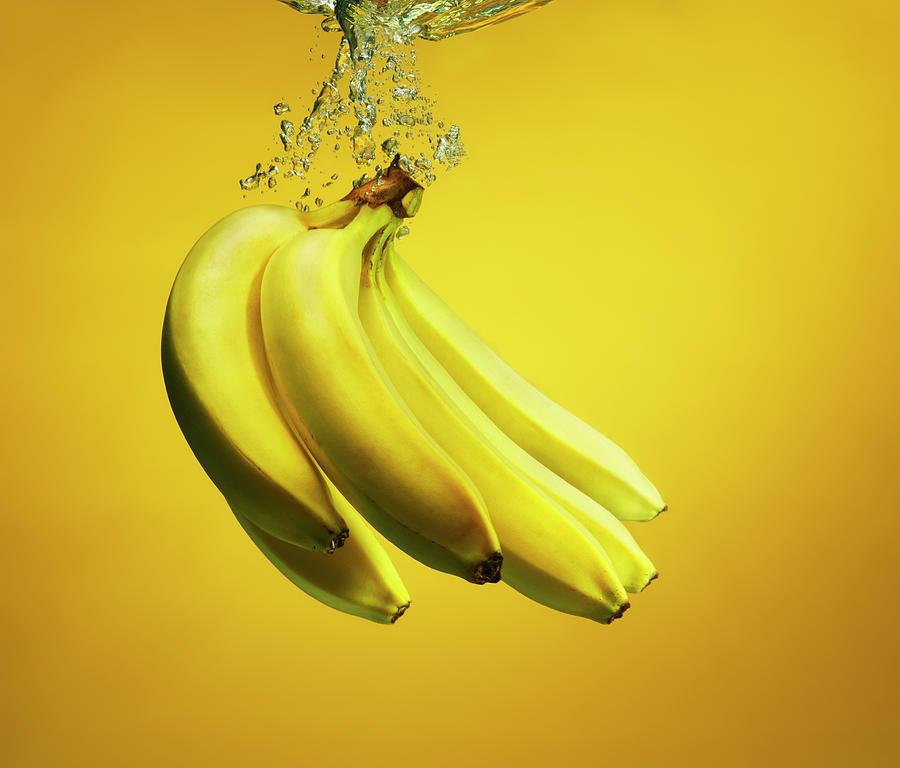 Bananas Splashed Into Water Photograph by Henrik Sorensen