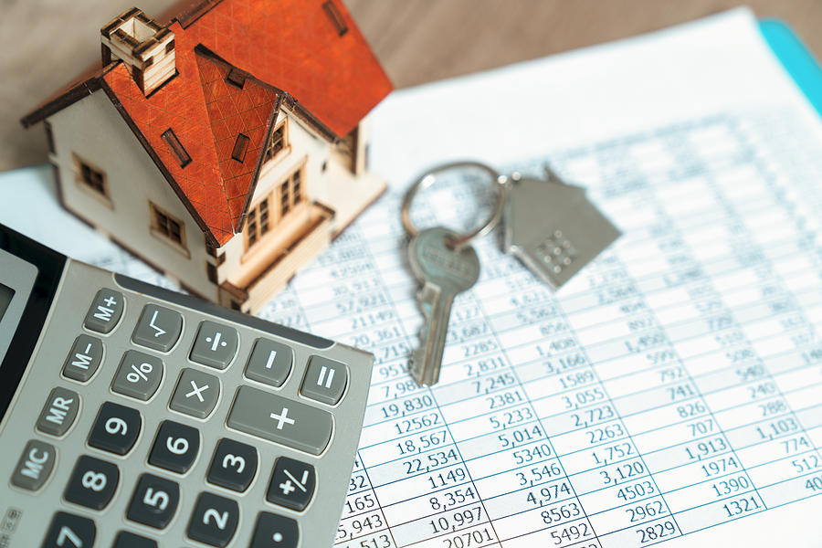 Bank Calculates The Home Loan Rate Photograph by Witthaya Prasongsin