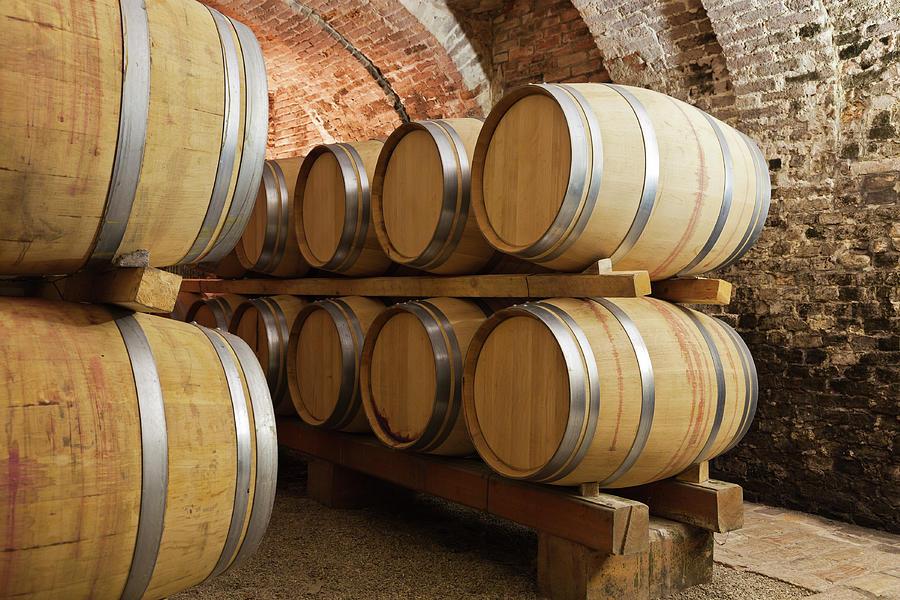 Barrels In Wine Cellar Photograph by Stockwerk