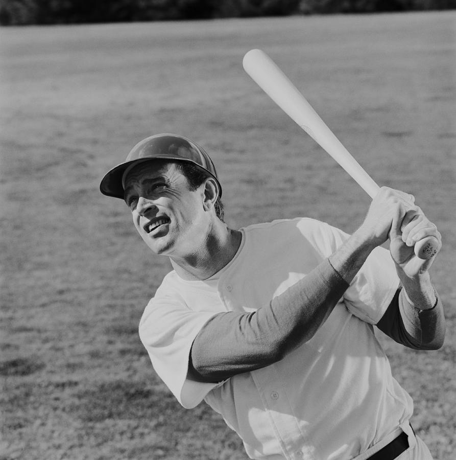 Baseball player swinging baseball bat Photograph by Tom Kelley Archive
