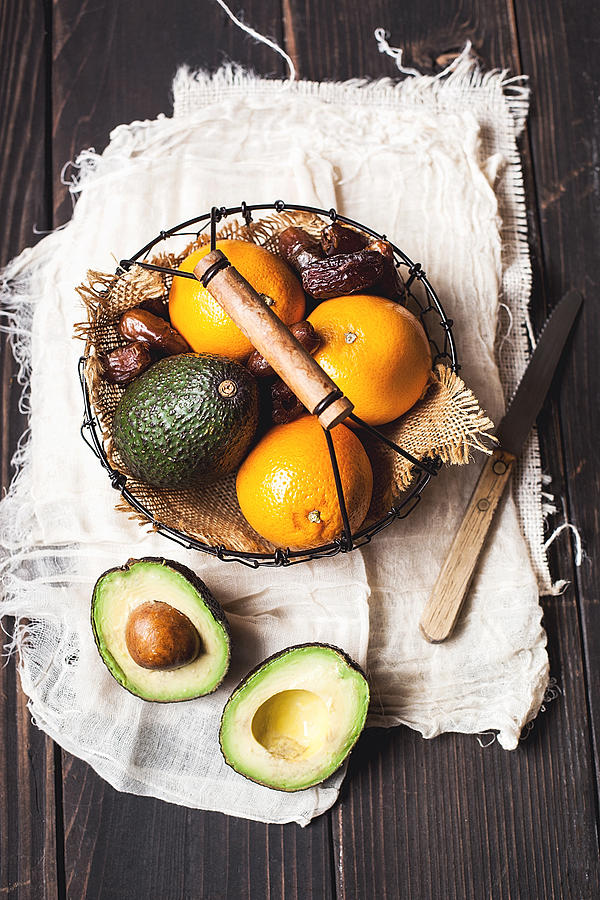 Basket With Avocado, Oranges And Dates Photograph by One Girl In The Kitchen
