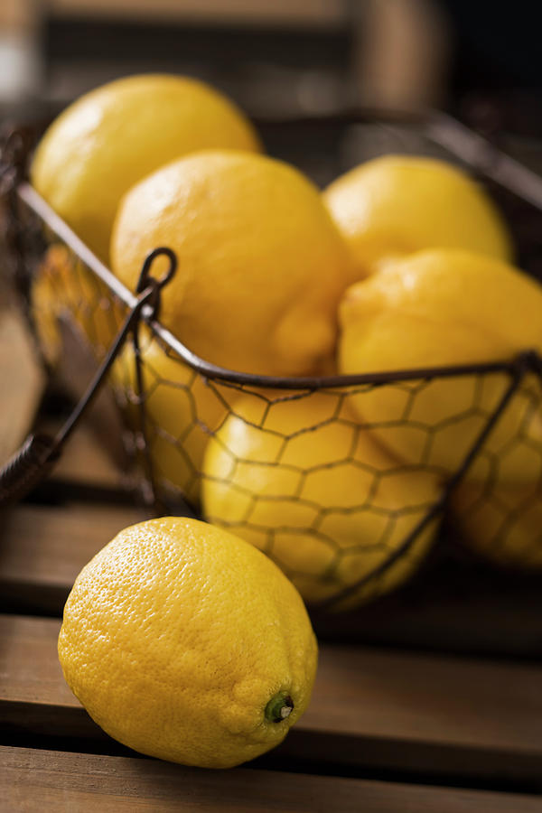 Basket With Organic Lemons Fresh From Photograph by Gmvozd