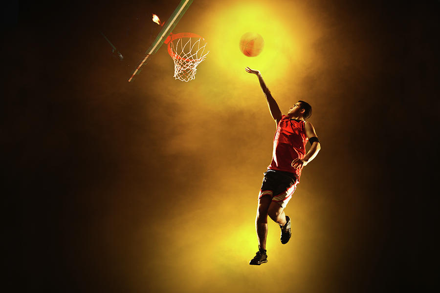Basketball Player Jumping With Glowing Photograph by Stanislaw Pytel