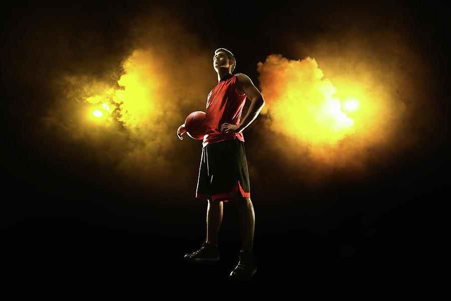 Basketball Player On Smoky Yellow Photograph by Stanislaw Pytel