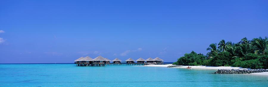 Color Image Photograph - Beach Cabanas, Baros, Maldives by Panoramic Images