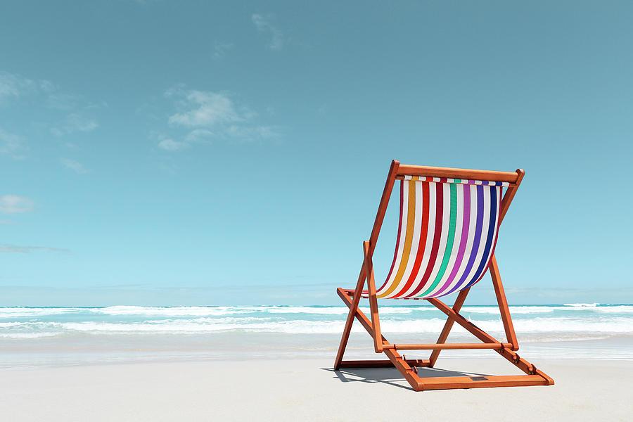 Beach Chair With Rainbow Stripes Photograph by John White Photos