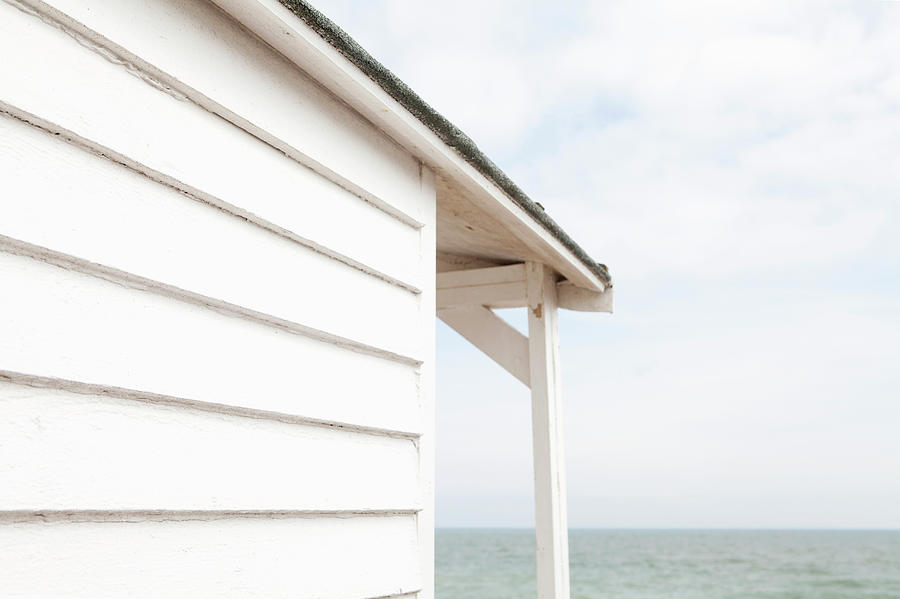 Beach Hut And The Sea Photograph by James French
