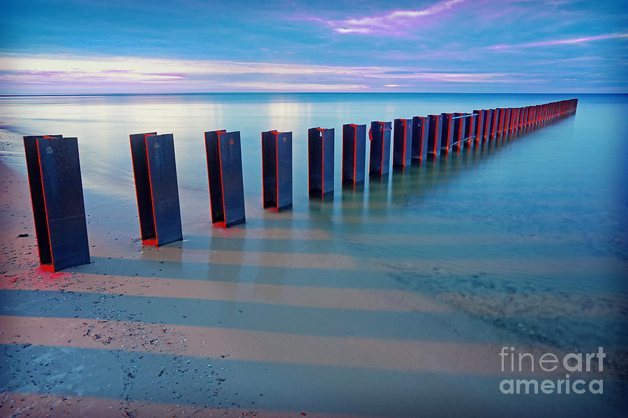Beach Pylons at Sunset by Martin Konopacki
