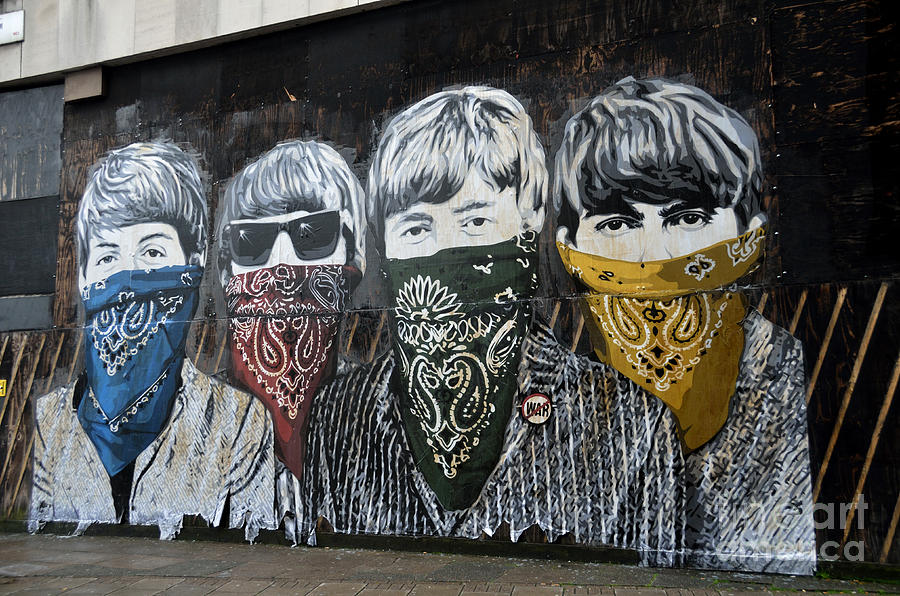 Banksy Photograph - The Beatles wearing face masks street mural by RicardMN Photography