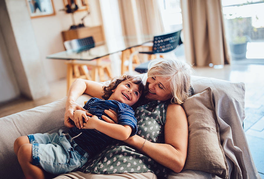 Beautiful grandma and grandson playing together having fun at home Photograph by Wundervisuals