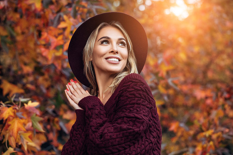 Beautiful woman enjoying in a sunny autumn day Photograph by CoffeeAndMilk