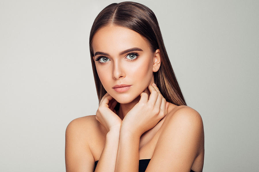 Beautiful woman. Soft make-up and perfect skin. Photograph by CoffeeAndMilk