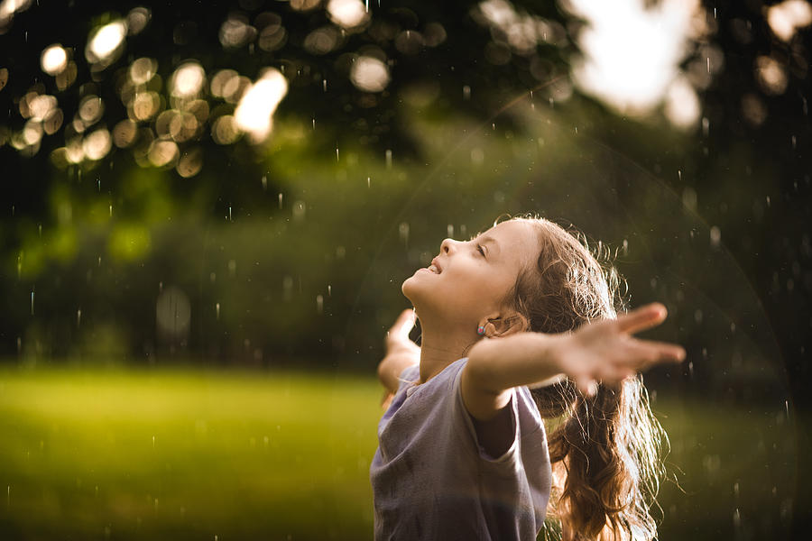 Beauty girl enjoying on the rain in nature Photograph by StockPlanets