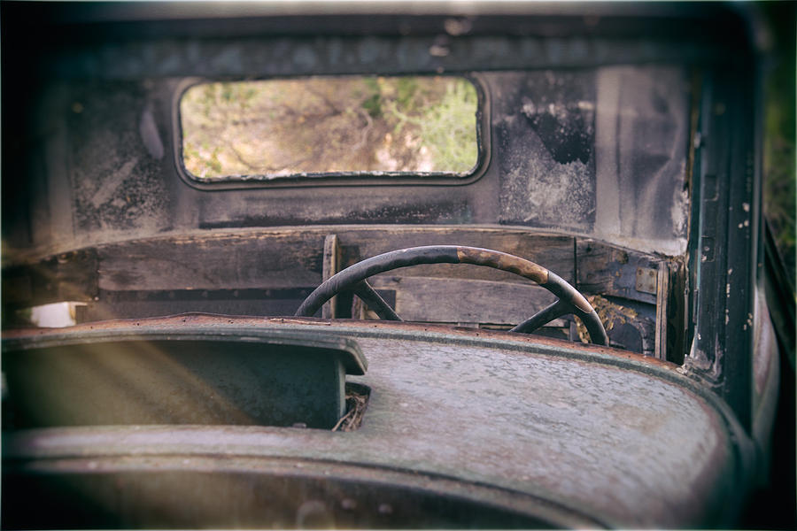 Abandoned Photograph - Behind The Wheel by Peter Tellone