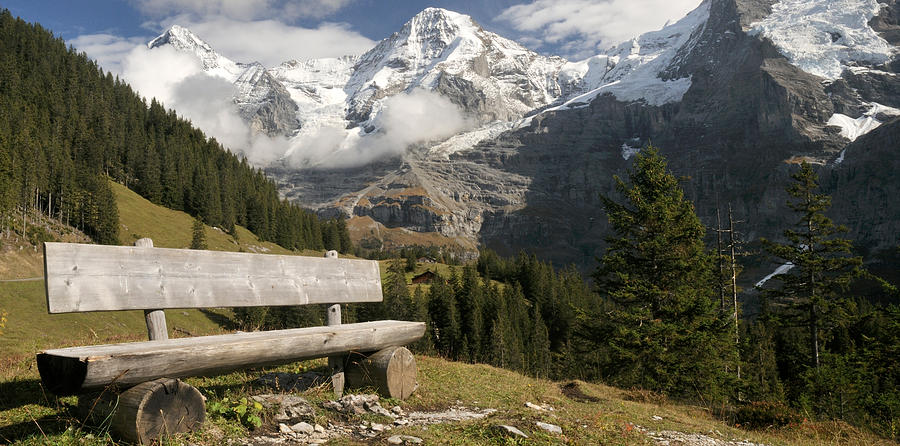 Color Image Photograph - Bench With Mt Eiger And Mt Monch by Panoramic Images