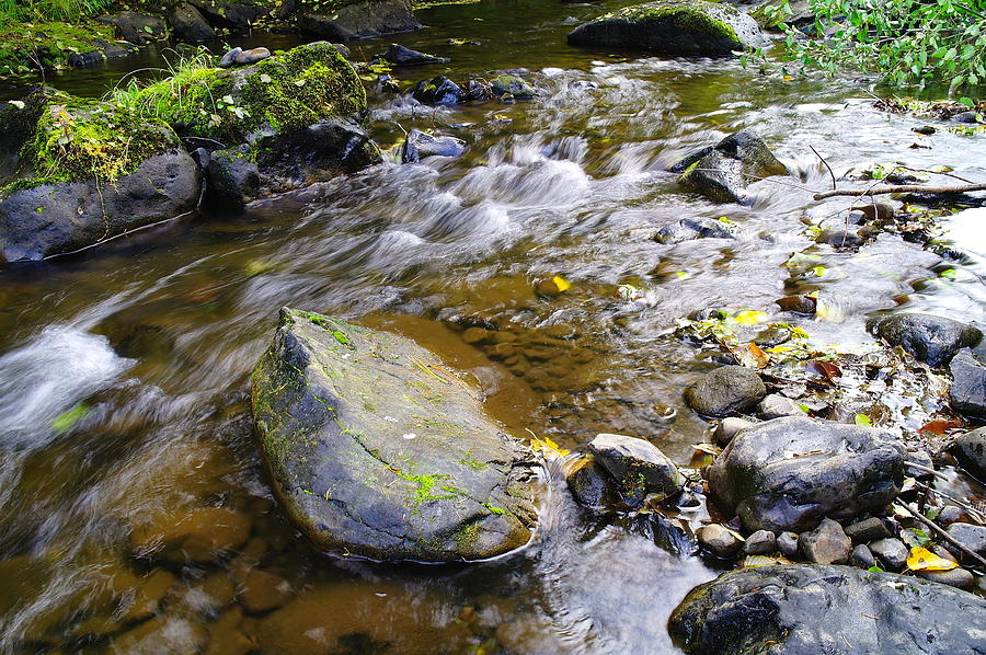 Water Photograph - Bending Between The Rocks by Jeff Swan