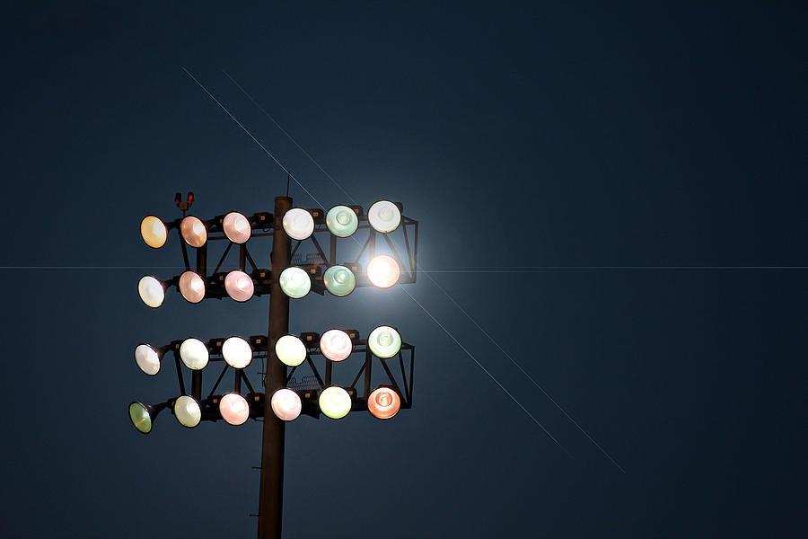Lights Photograph - Beneath Friday Night Lights by Trish Mistric