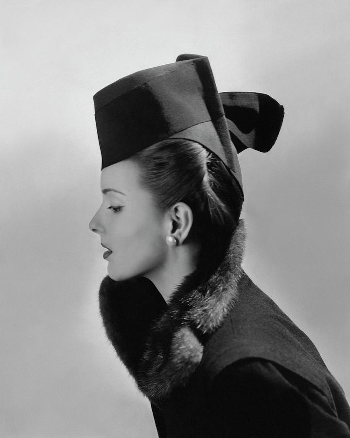 Bettina Bolegard Wearing A Chechia Hat Photograph by Horst P. Horst