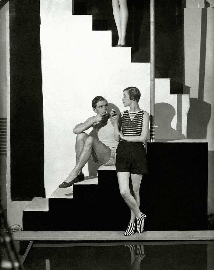 Bettina Jones Posing With A Male Model Photograph by George Hoyningen-Huene