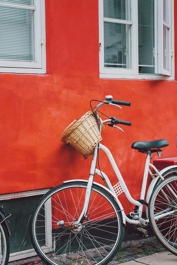 Bicycle Leaning On Red Wall Photograph by Julia Davila-lampe
