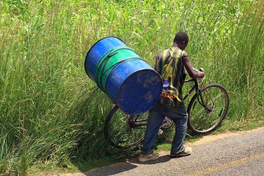 Africa Photograph - Bicycle Strain by Aidan Moran