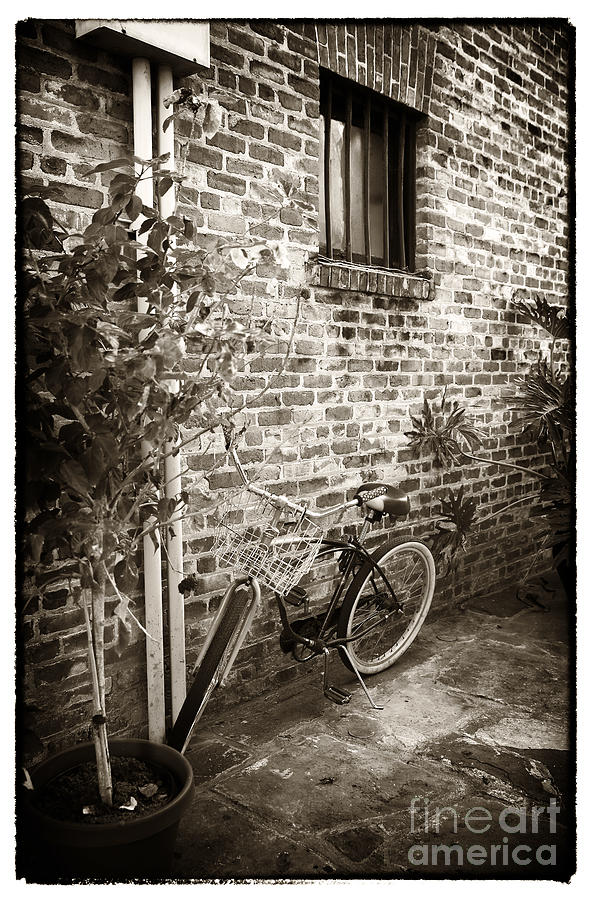 Bike Photograph - Bike In Pirates Alley by John Rizzuto