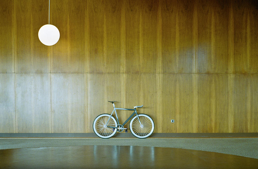 Bike Parked Against Wood Paneling Photograph by Dejan