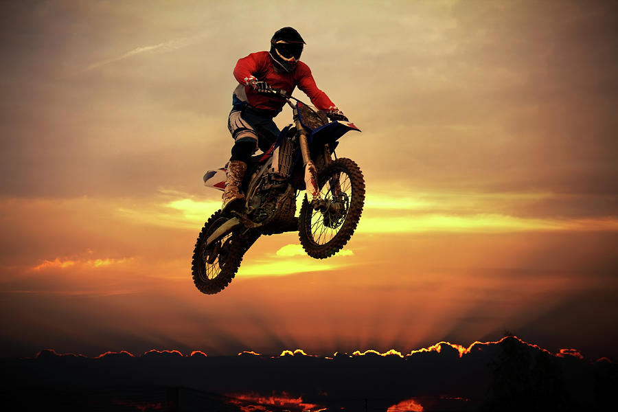 Biker On Motorcycle Jumping Over Clouds Photograph by Sergiy Trofimov Photography